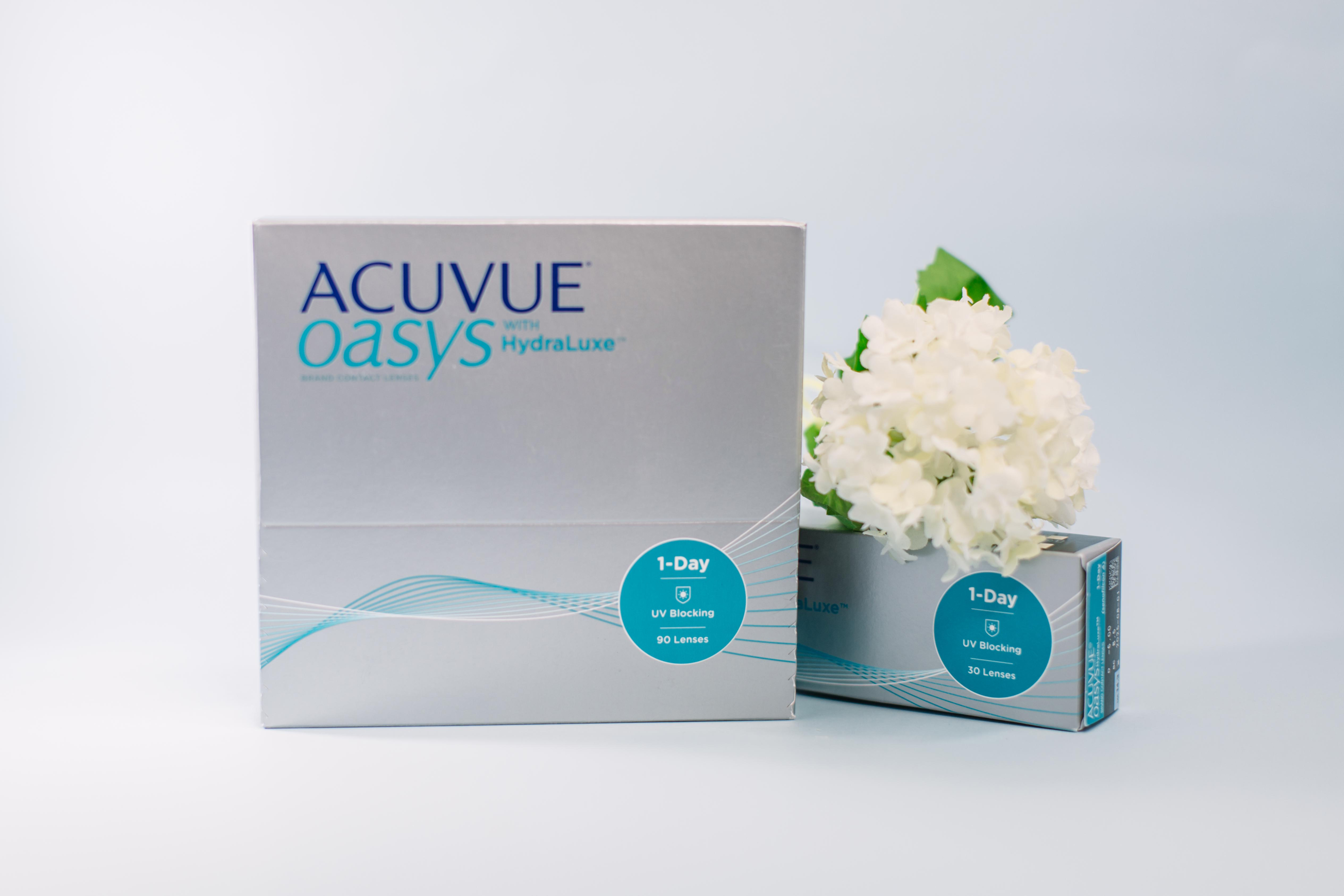 2 boxes of Acuvue contact lenses with white flowers