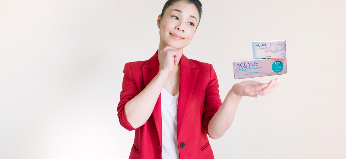 Lady holding a stack of contact lenses floating on her hands