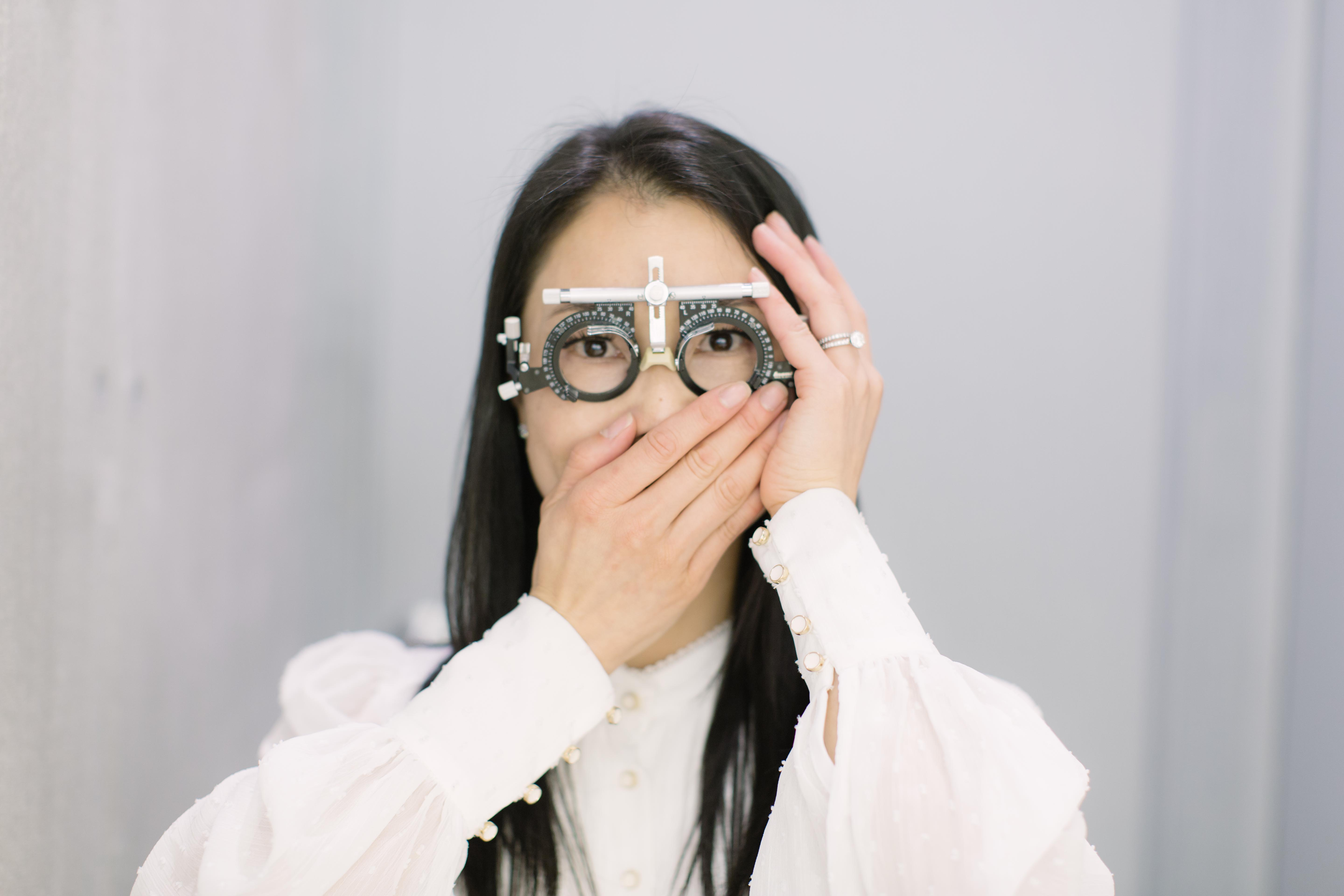 An Asian Woman wearing Trial glasses